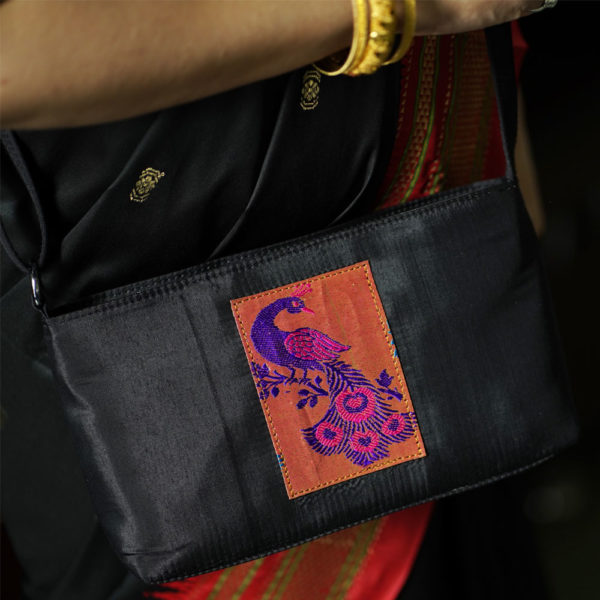 Black-colour-and-ping-colour-peacock-design-sling-bag